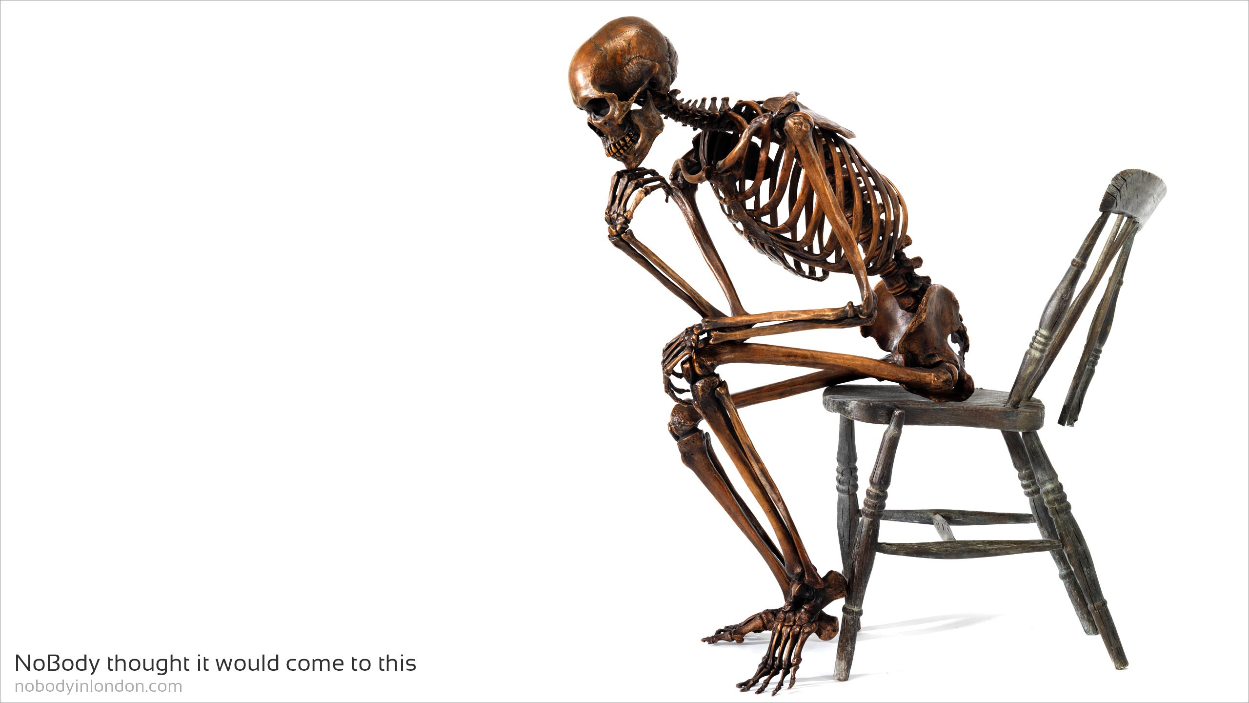 NoBody thought it would come to this life size bronze skeleton sitting on distressed bronze chair brilliant investment